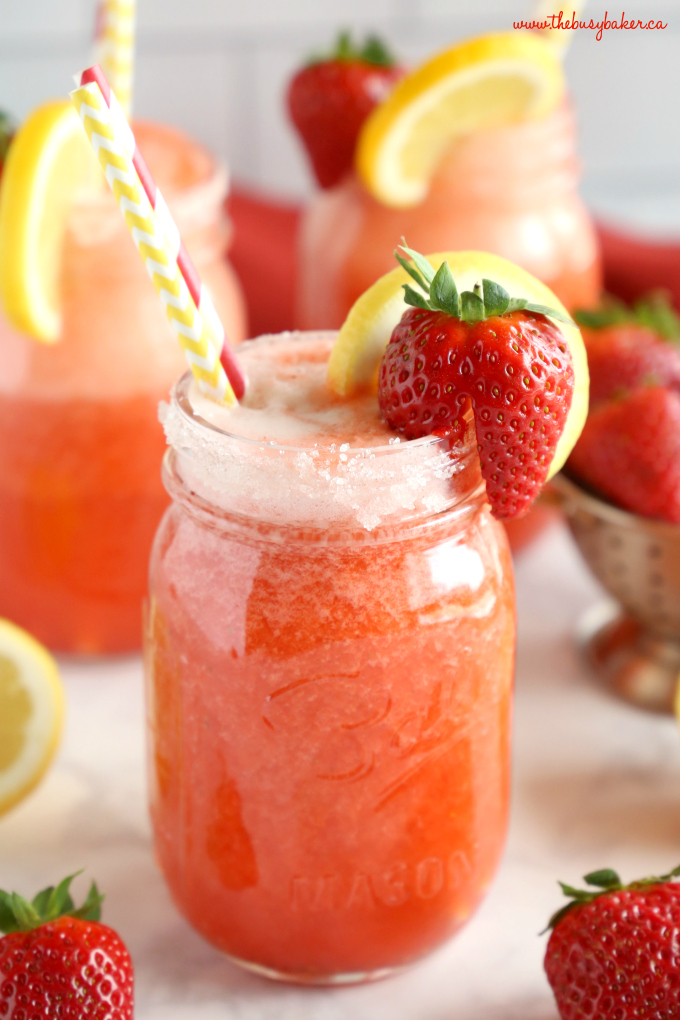 Healthy Strawberry Lemonade drink with straws in mason jar