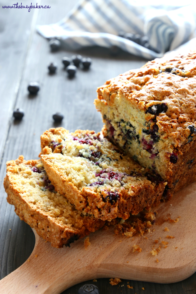 This Lemon Blueberry Oat Bread is the perfect sweet coffee break snack! It's easy to make and packed with whole grains for a healthy twist! Recipe from thebusybaker.ca! #oatbread #lemonblueberrybread #muffinrecipe