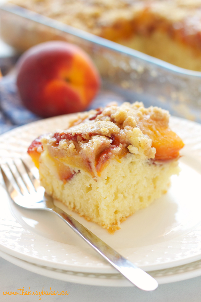 Peach Streusel Cake with fresh peaches on white plate with fork