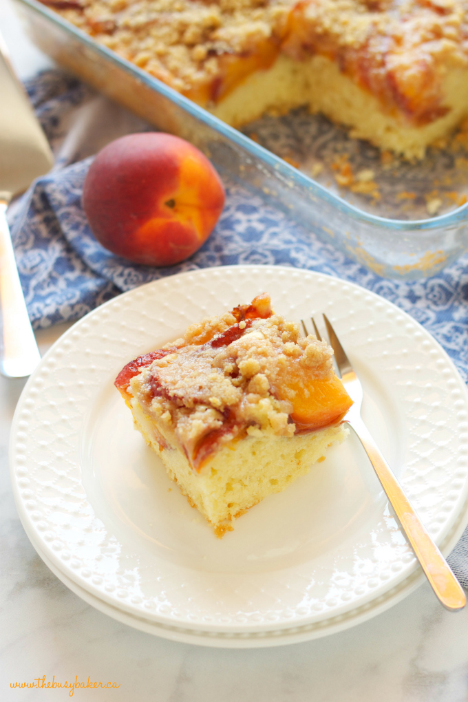 Peach Streusel Cake with cake pan and white plate with fork