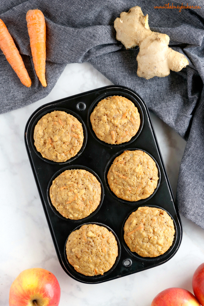 Apple Carrot Muffins in muffin tin with apples and ginger root