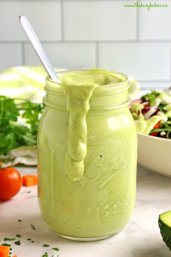 Healthy Creamy Avocado Ranch Salad Dressing in Mason Jar overflowing