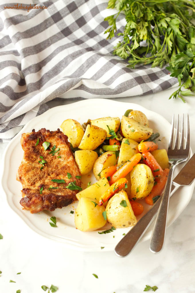Easy Pork Chop Sheet Pan Dinner on plate with knife and fork