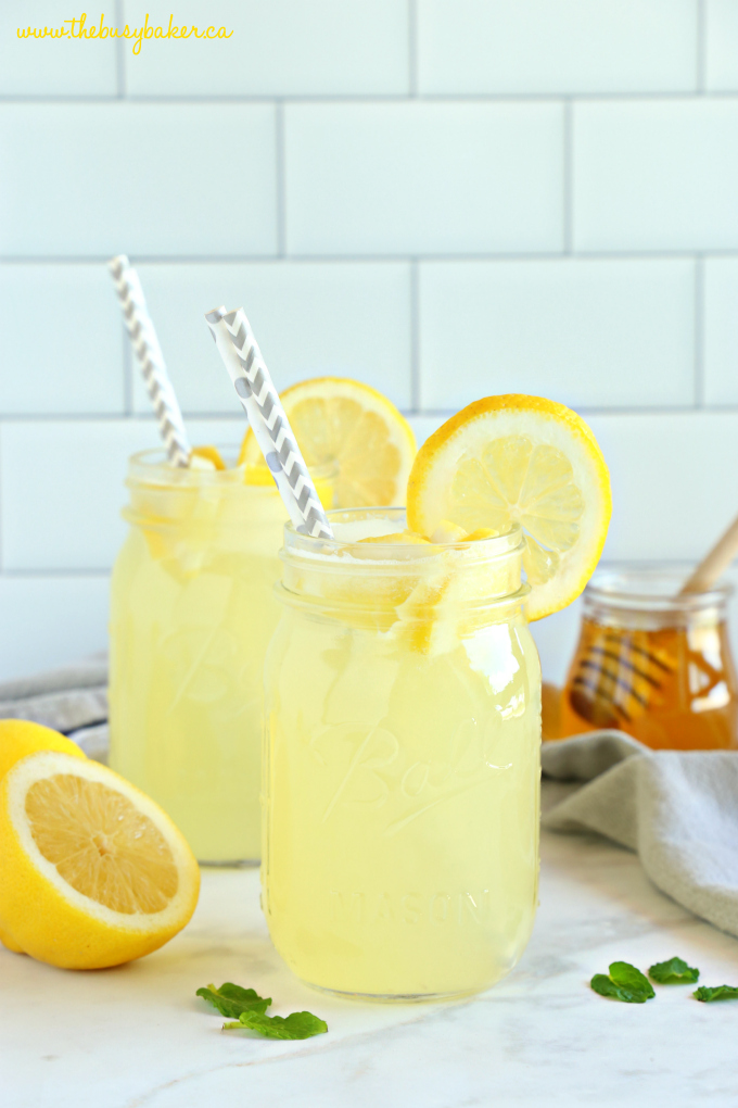 Healthy 3-Ingredient Lemonade with paper straws and lemon slices