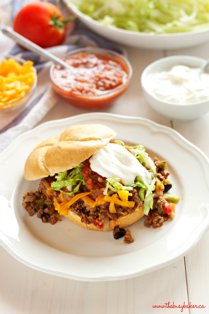 One Pan Mexican Style Sloppy Joes on plate with salsa and sour cream
