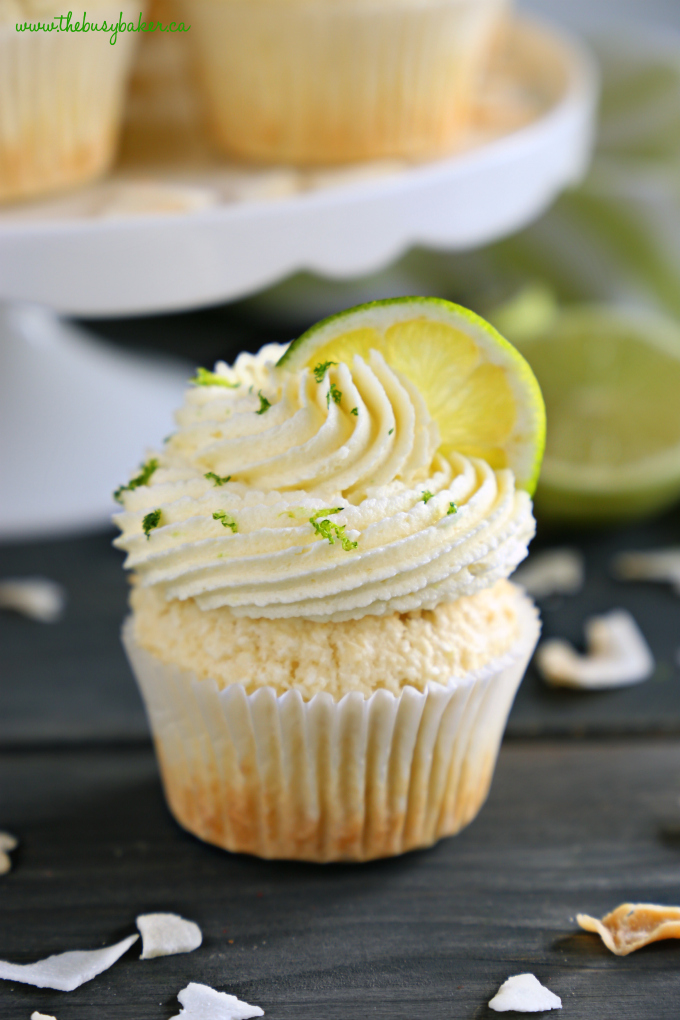 Dairy-Free Coconut Lime Cupcakes with lime slice and coconut