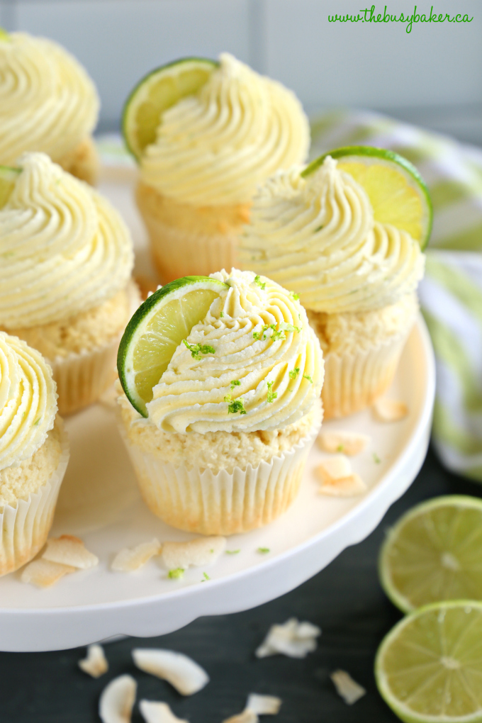 Dairy-Free Coconut Lime Cupcakes on platter with limes