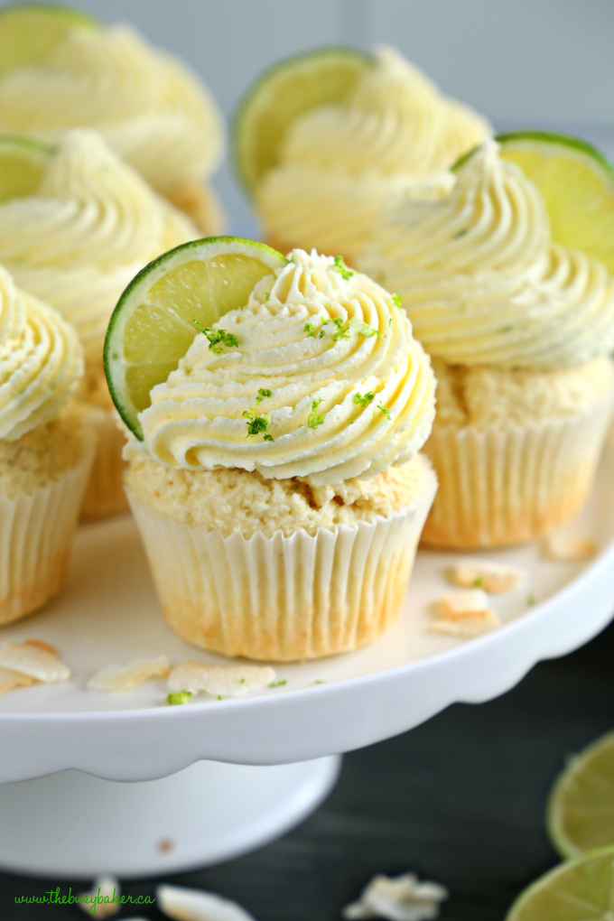 Dairy-Free Coconut Lime Cupcakes with lime zest on a cake stand