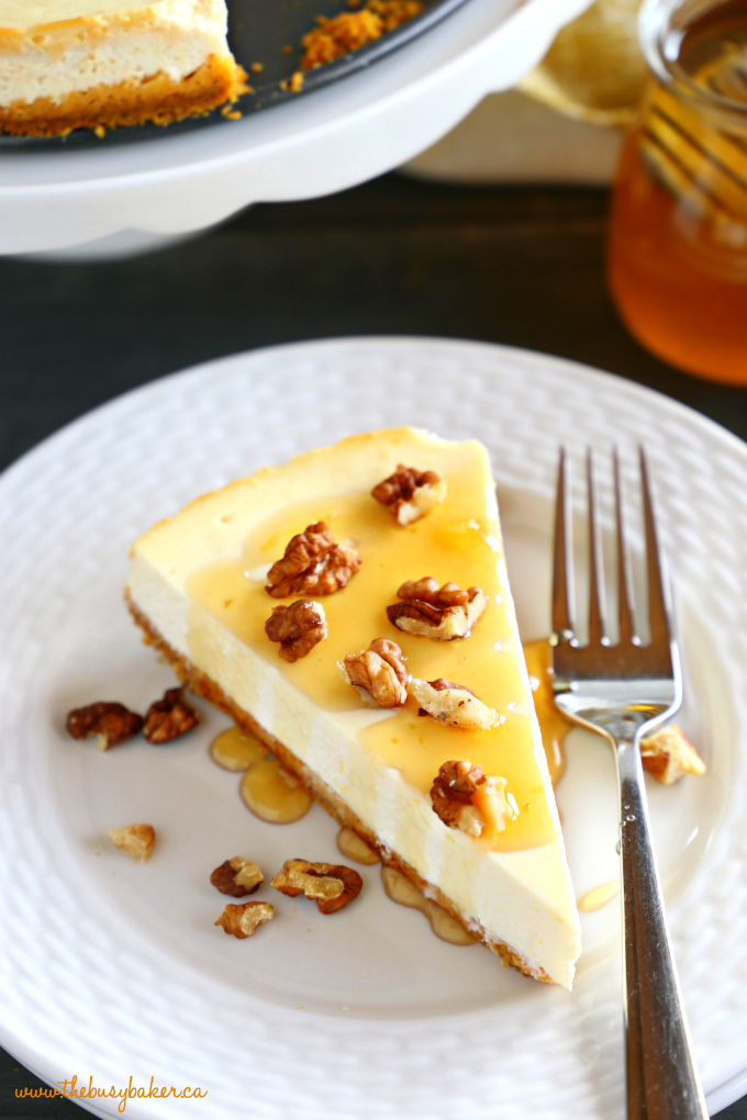 Healthy Honey Greek Yogurt Cheesecake with honey and walnuts on white plate with fork
