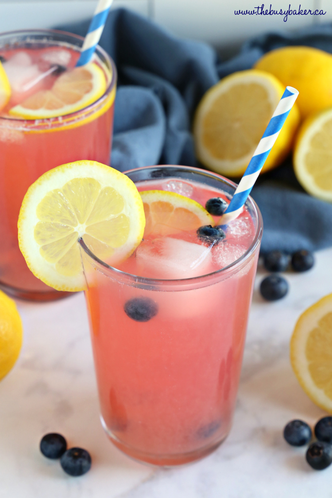 Healthy Blueberry Lemonade with blue kitchen towel and lemon slices
