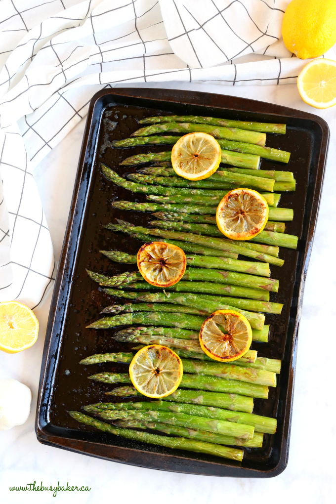 Lemon Garlic Roasted Asparagus on baking sheet with lemon slices