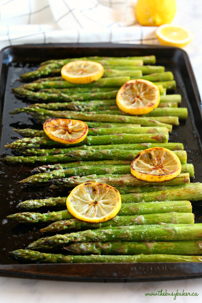 This Lemon Garlic Roasted Asparagus on baking sheet with lemons