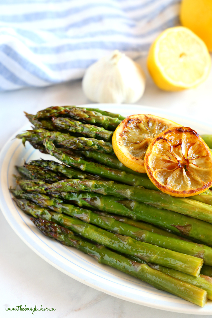 Lemon Garlic Roasted Asparagus on platter with lemon slices
