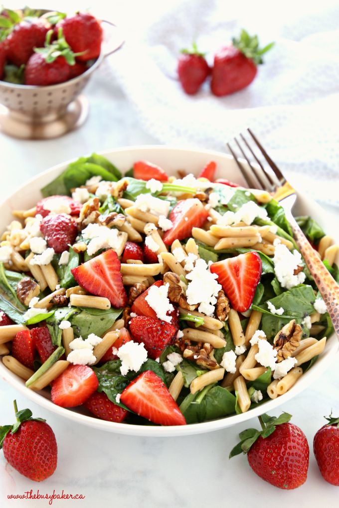 Strawberry Spinach Pasta Salad with strawberries and copper fork