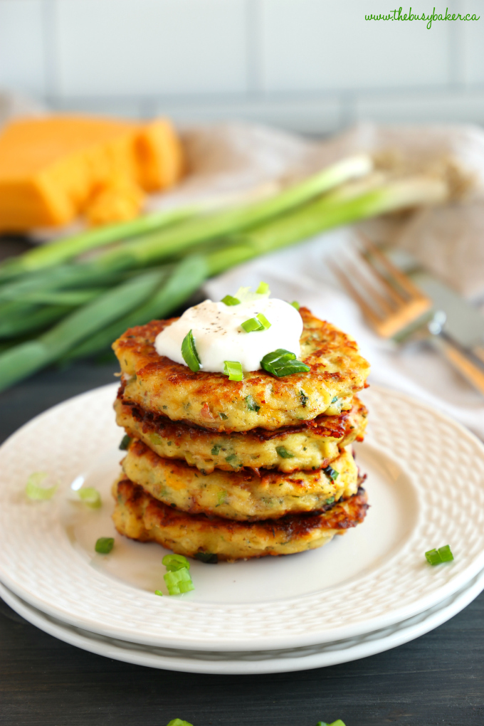 Cheesy Leftover Mashed Potato Pancakes with cheese and green onions and sour cream on plate