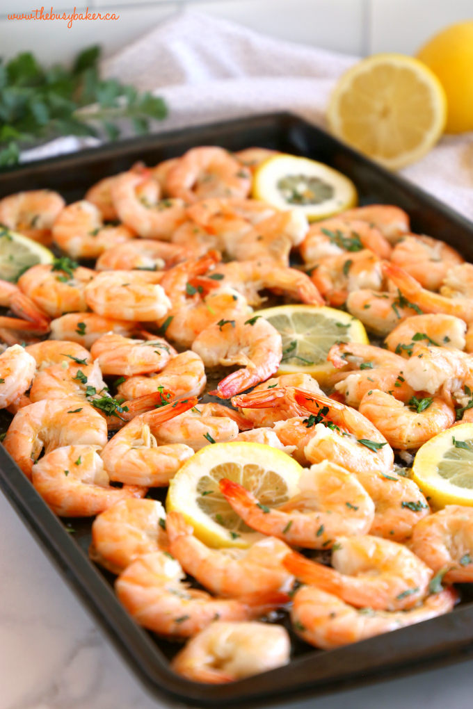 Easy Roasted Garlic Butter Shrimp on baking sheet with lemon slices