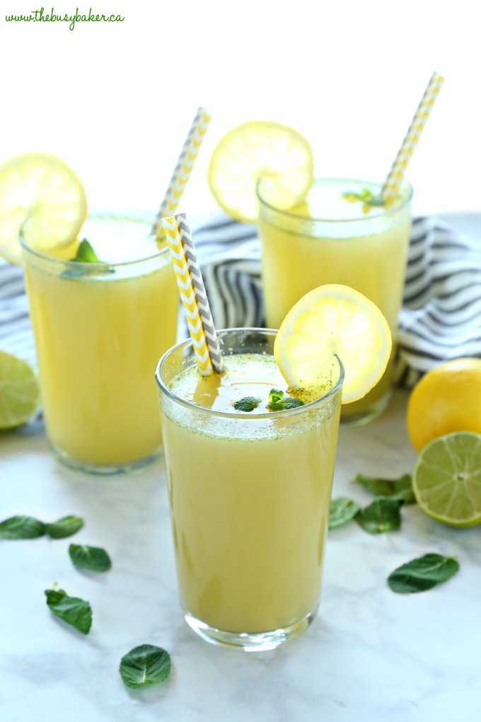 Healthy Sparkling Mojito Lemonade in glass with paper straws and fresh mint