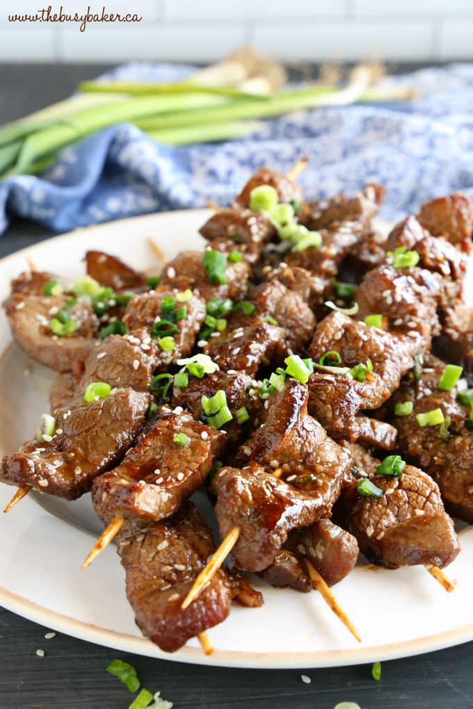 Best Ever Korean Barbecue Beef Skewers with sesame seeds on the grill