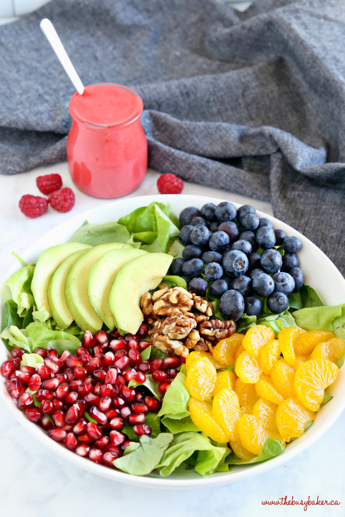 Orange Berry Pomegranate Superfood Salad with blueberries and walnuts