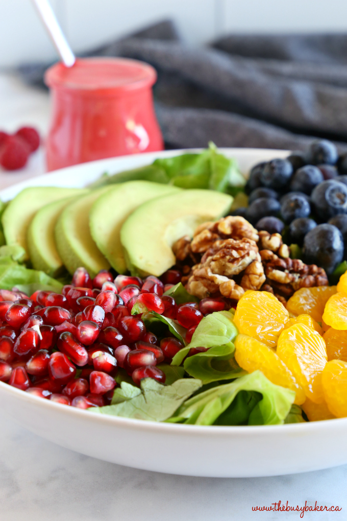 Orange Berry Pomegranate Superfood Salad with walnuts and oranges and raspberry dressing