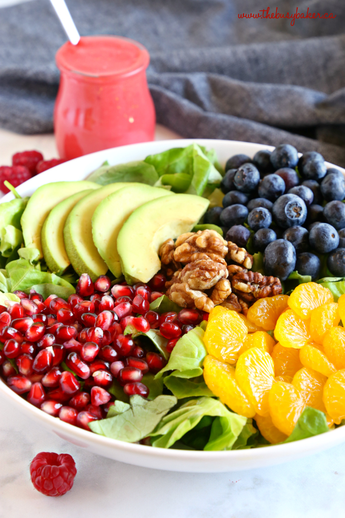 Orange Berry Pomegranate Superfood Salad with raspberry vinaigrette