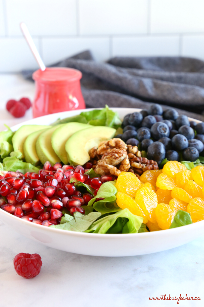 Orange Berry Pomegranate Superfood Salad with raspberries