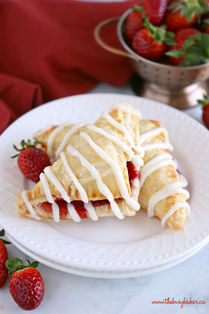 Easy Strawberry Hand Pies with strawberry filling and fresh strawberries