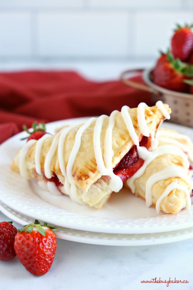 Easy Strawberry Hand Pies with strawberry filling and sweet glaze frosting