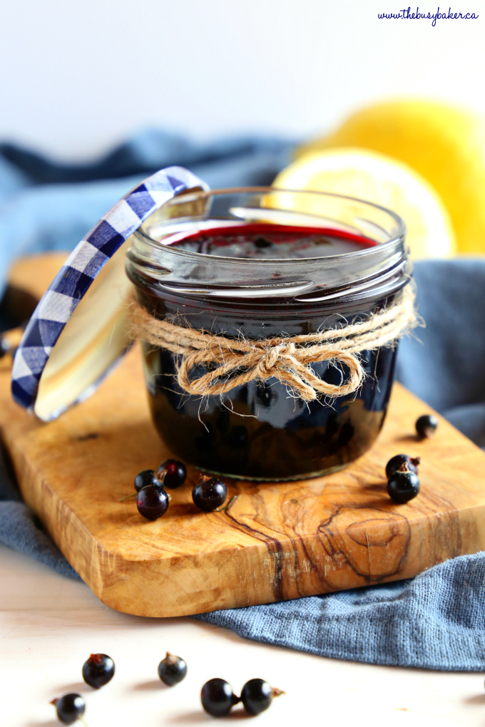 Best Ever Black Currant Jam in mason jar with blue lid
