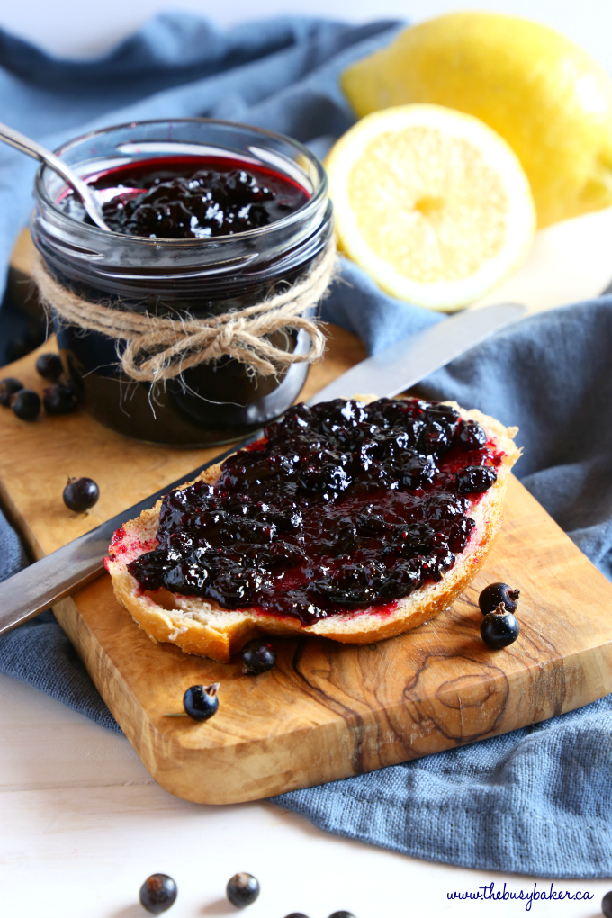 Best Ever Black Currant Jam on crusty bread with jar and knife