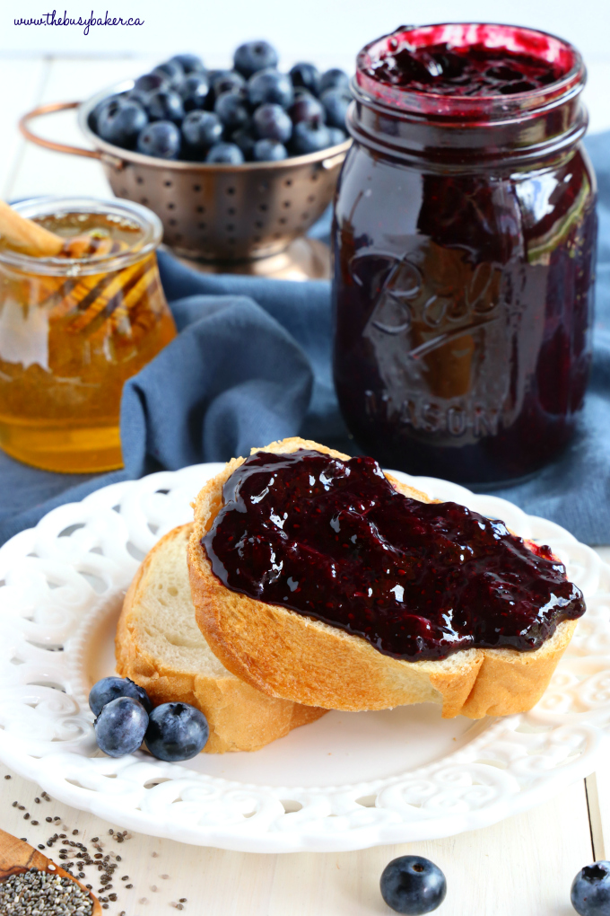 Healthy 3-Ingredient Chia Seed Blueberry Jam on bread with jam jar