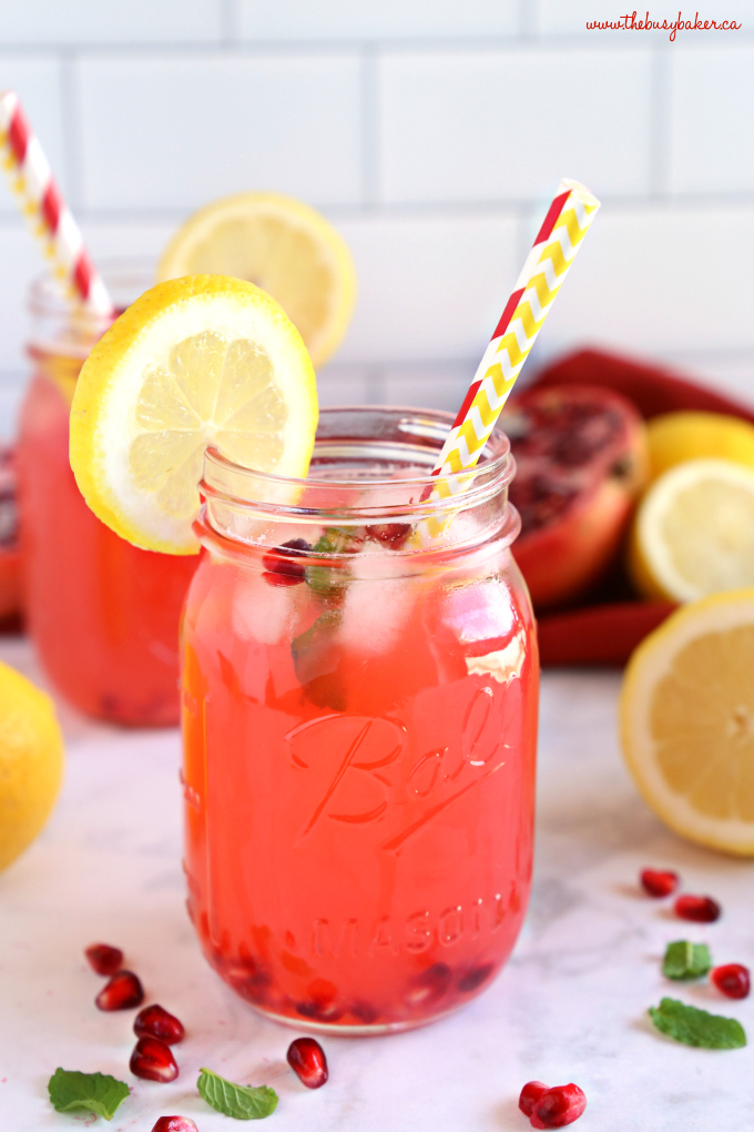 Healthy Pomegranate Lemonade in mason jar with paper straws
