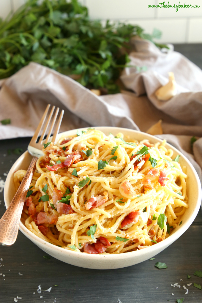 Easy 15-Minute Pasta Carbonara in pasta bowl with copper fork and fresh parmesan
