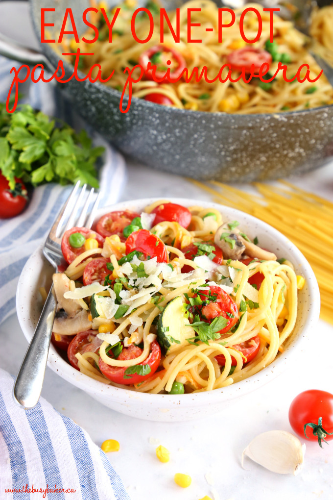 Easy One Pot Pasta Primavera in white speckled pottery bowl with fresh tomatoes