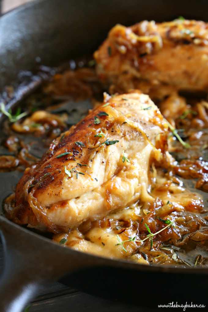 Easy One Pan French Onion Stuffed Chicken with fresh thyme sprigs