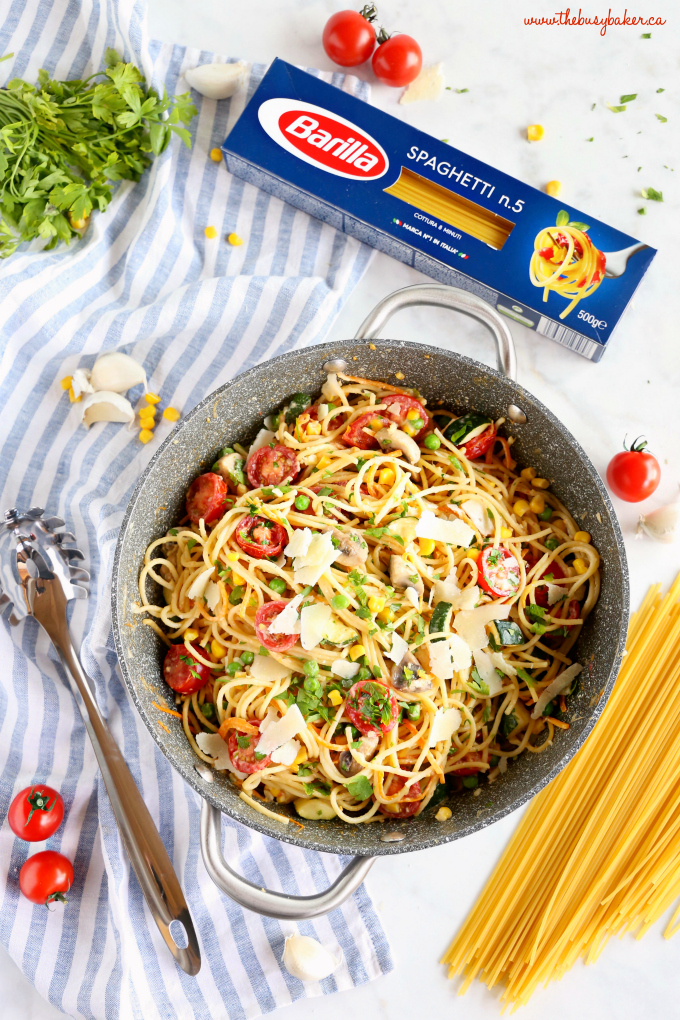 Easy One Pot Pasta Primavera in non-stick pan with fresh veggies and herbs