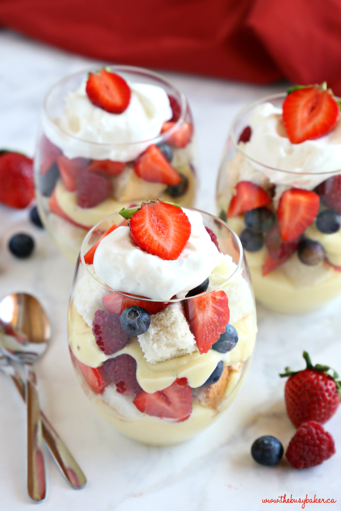 Vanilla Bean Angel Food Cake Trifles with Fresh Berries in stemless wine glasses with spoon