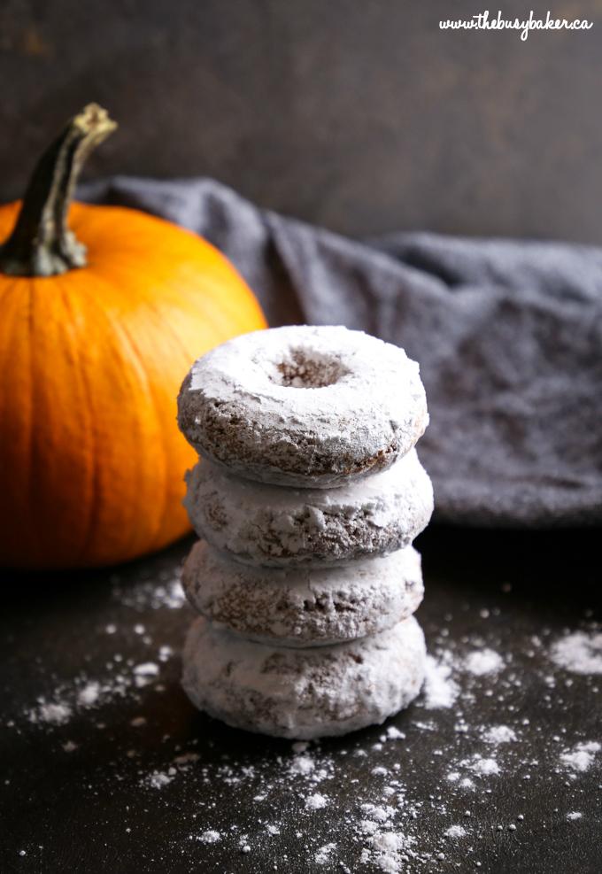Pumpkin Spice Baked Donuts in powdered sugar