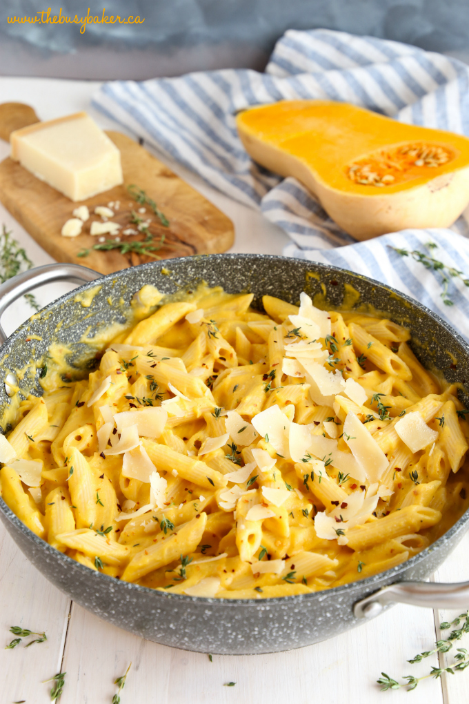 Creamy One Pot Butternut Squash Pasta in pot with parmesan cheese and thyme