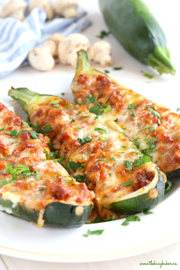 Easy Low Carb Pizza Stuffed Zucchini with fresh herbs and cheese