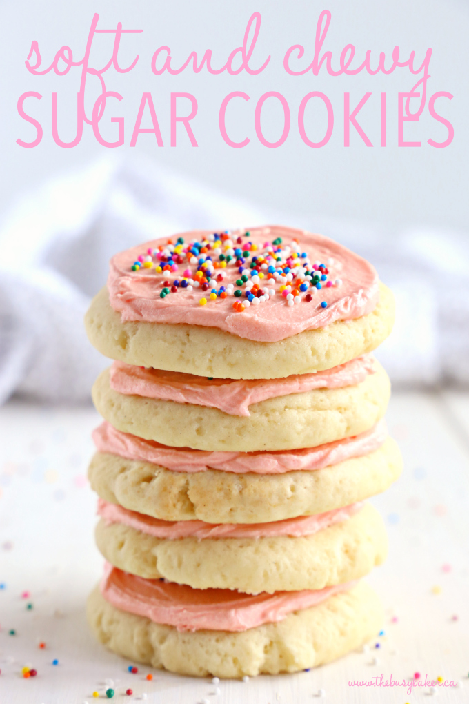 stack of Soft and Chewy Frosted Sugar Cookies with pink frosting and sprinkles