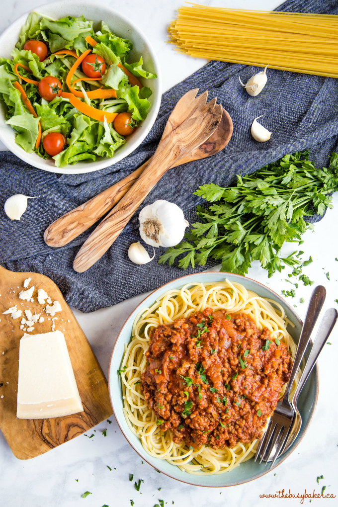 Best Ever Spaghetti and Meat Sauce tablescape with salad