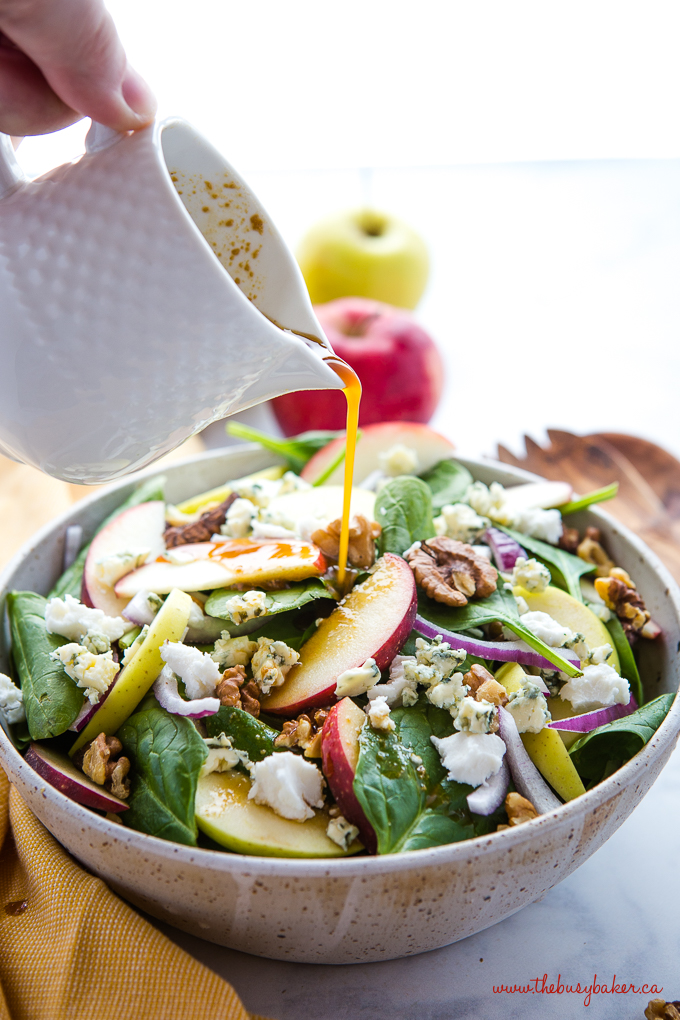 Apple Walnut Spinach Salad with Balsamic Vinaigrette Dressing in pottery bowl with apples