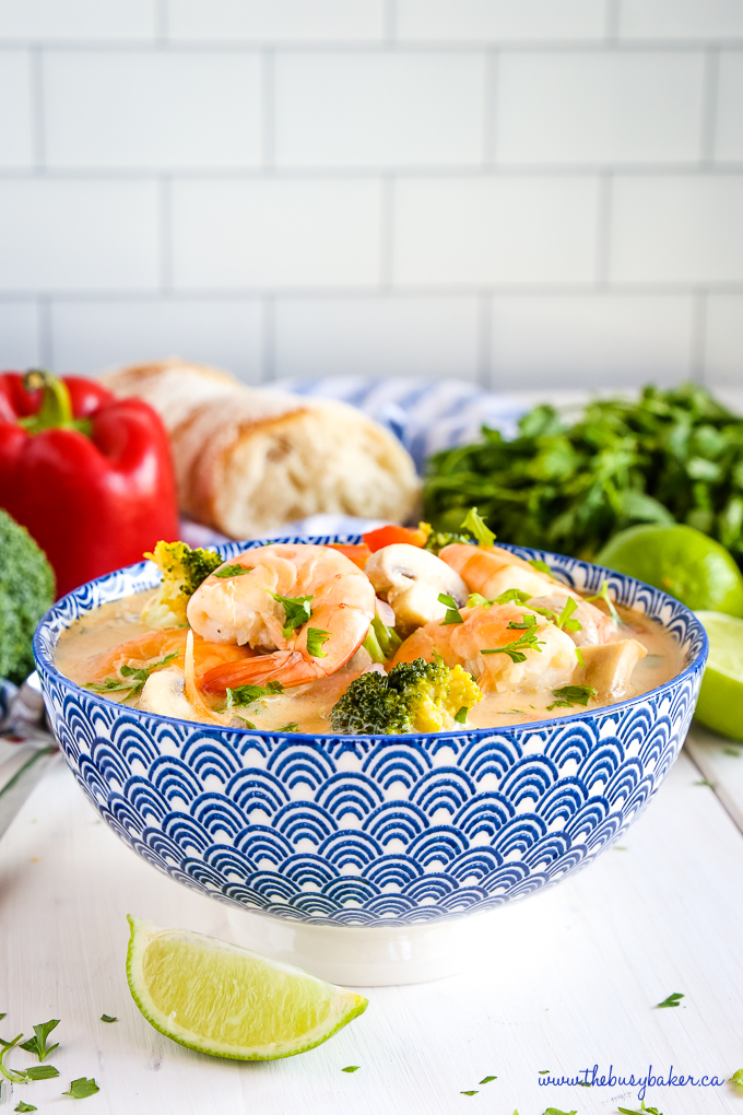 Thai Coconut Curry Shrimp Soup in blue bowl on kitchen counter