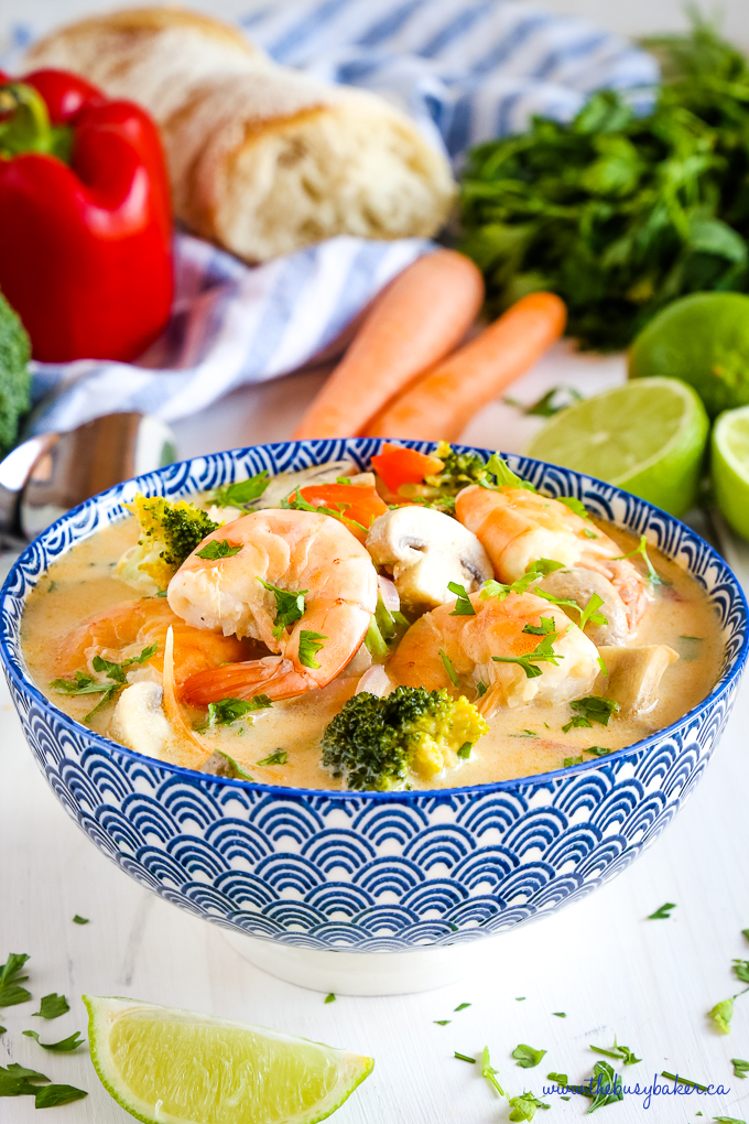 Thai Coconut Curry Shrimp Soup in blue bowl with crusty bread