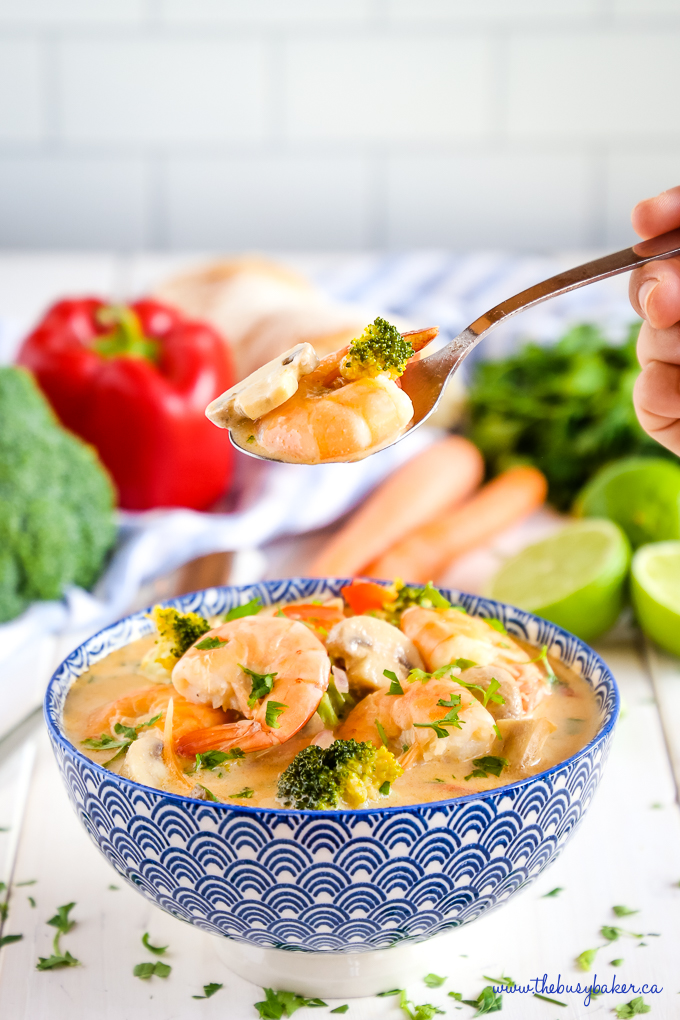 Thai Curry Coconut Shrimp Soup in blue bowl with broccoli