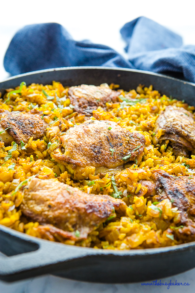 Easy One Pan Chicken with Turmeric Rice in cast iron pan