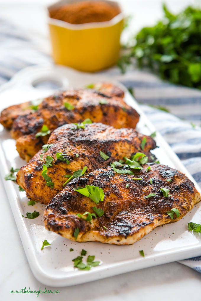 Easy Cajun Grilled Chicken with fresh herbs on white plate