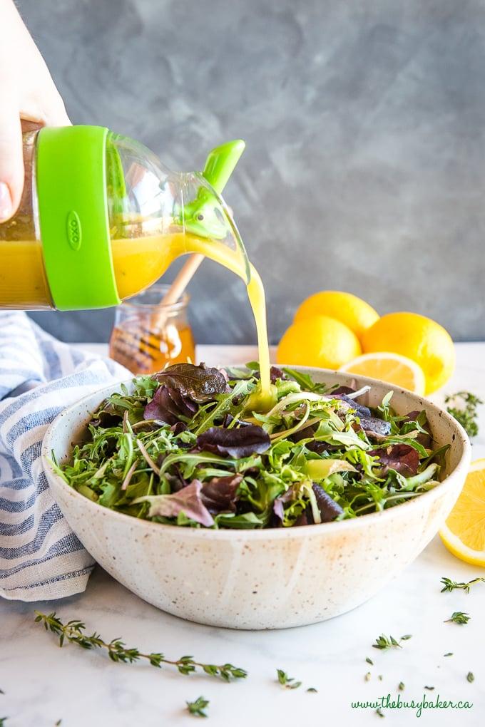 Honey Lemon Vinaigrette Salad Dressing poured onto salad