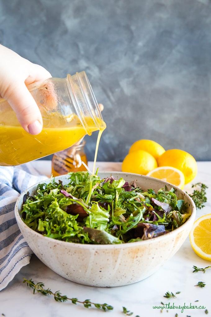 easy and healthy Honey Lemon Vinaigrette Salad Dressing pouring onto salad